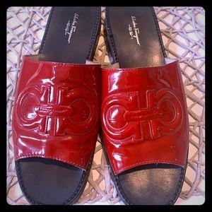 Salvatore Ferragamo red sandals.